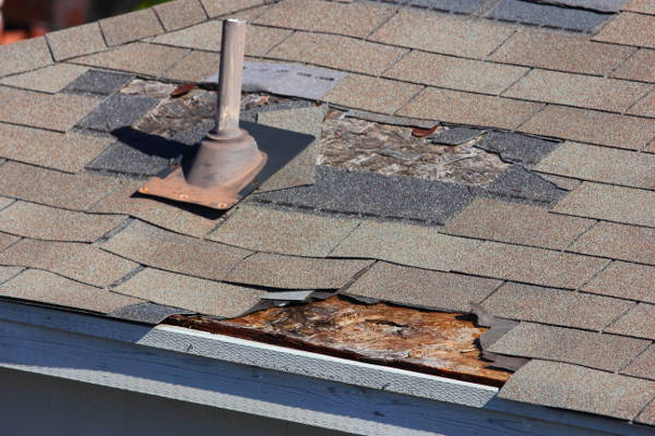 severely damaged garage roof